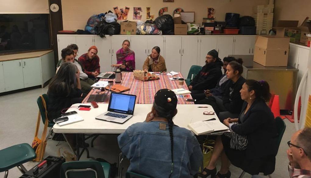 Wild Salmon Caravan planning team session in progress. Team sitting around a table.